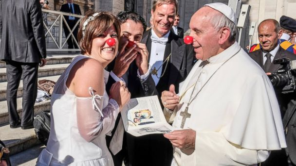 Pope Francis blessing the marriage of professional clowns in a moment of joy